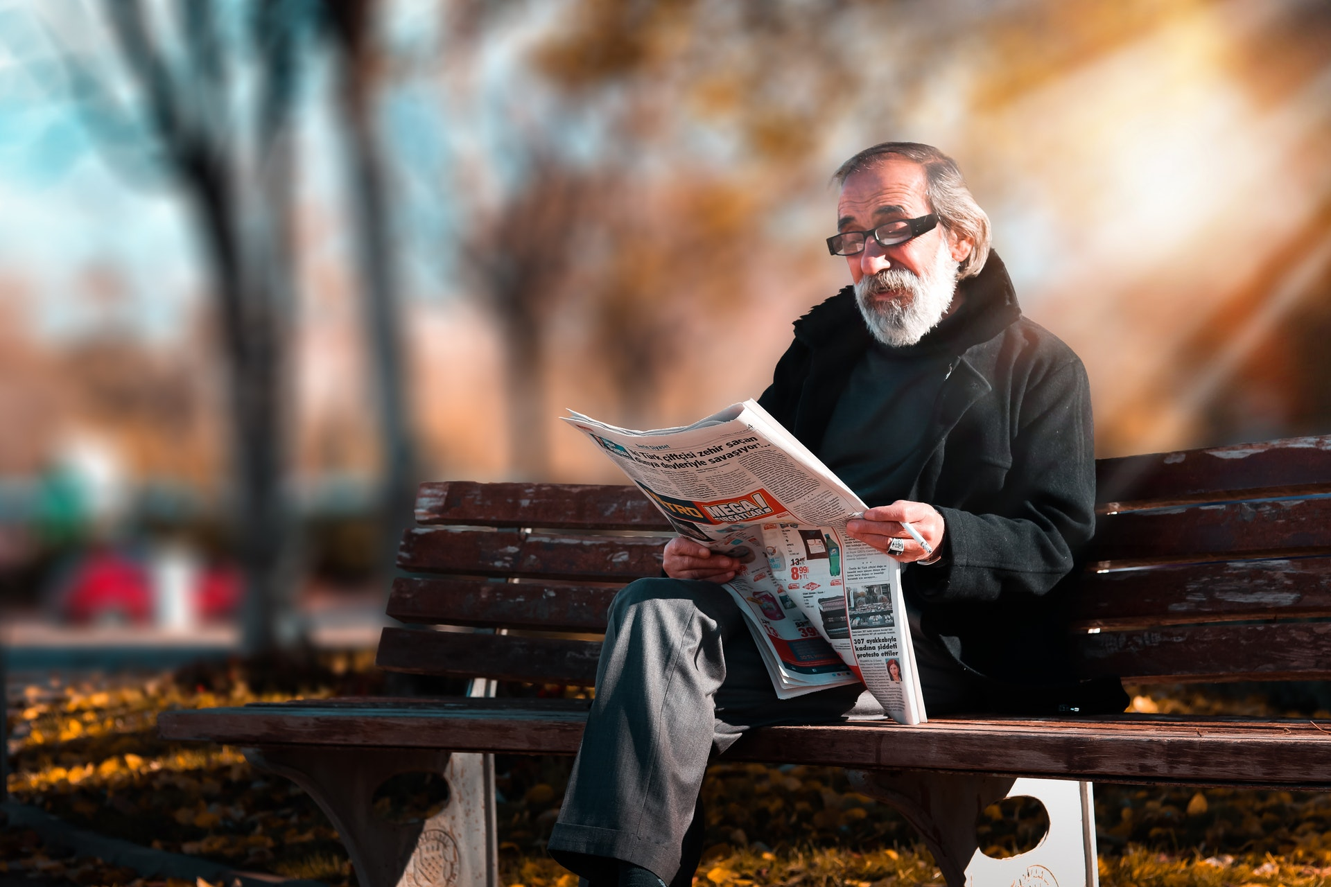 photo-of-man-reading-newspaper-1652340